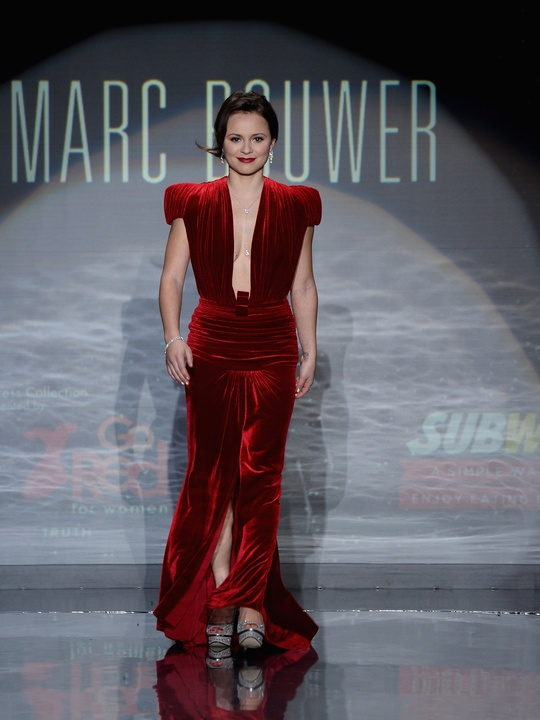 Sasha Cohen walks the runway wearing Marc Bouwer at Go Red For Women February 2014