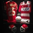 Jerseys and helmets in Lamar Hunt Family Sports Hall at Perot Museum of Nature and Science