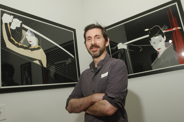 Craig Drake next to his two Kill Bill pieces