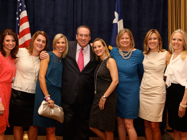 Ashley Stevens, from left, Kathryn Roark, Paige Lane, Mike Huckabee, Allison Stasney, Mary Clark Granberry, Cecie Turlington and Laurence Bragg at the LifeHouse fundraiser October 2013