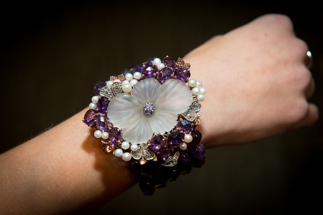 15 This bracelet is a one-of-a-kind piece made of amethyst, rose gold, silver, diamonds, and pearls -- valued at $25,000 and donated by Valobra Jewelry for Pin Oak's online silent auction at the Valobra Pin Oak holiday party December 2014