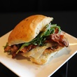 Texans tasting September 2014 sandwich with bacon