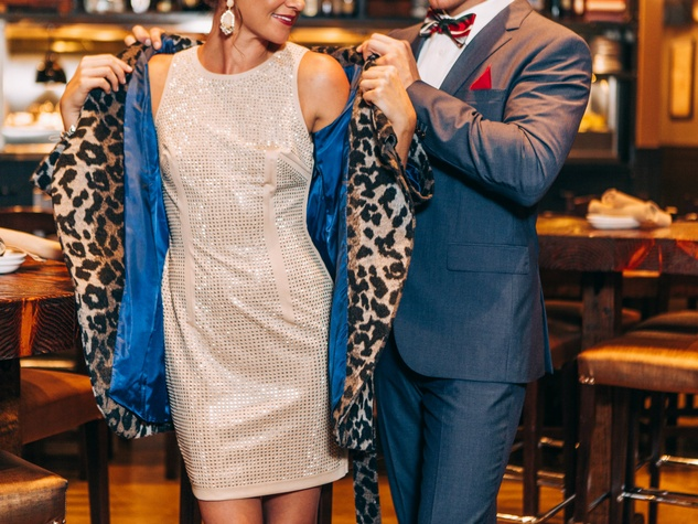 Couple dressed for holiday party at Shops at Park Lane