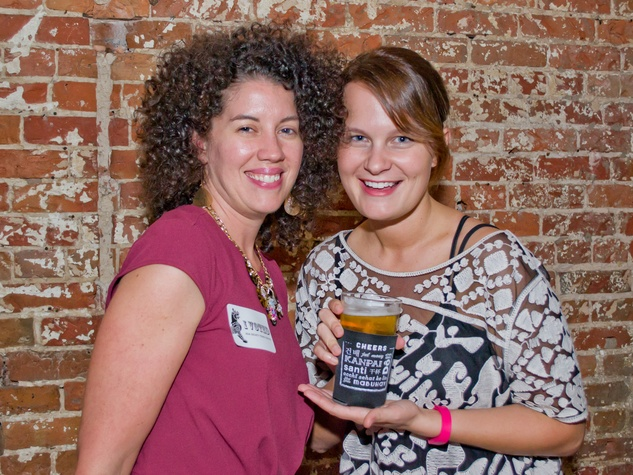 20 Megan Raines, left, and Bronwyn Walker at the Young Professionals Grand Prix kick-off party June 2014