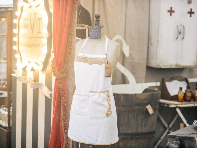 The Vintage Round Top apron at booth