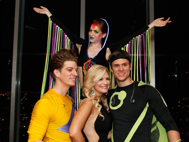 413 Tammie Johnson, center with members of the Space Rockers and a Glo-Glo Dancer at the STAGES Xanadu Gala April 2014