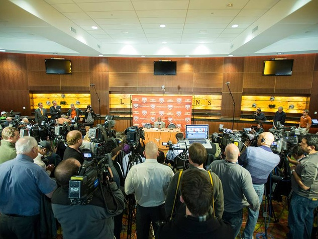 Charlie Strong with media and press at introduction in January 2014