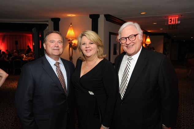 Jim Mills, from left, Brenda Stardig and Greg Ortale at the Houston Arts Alliance event with Rita Moreno May 2014