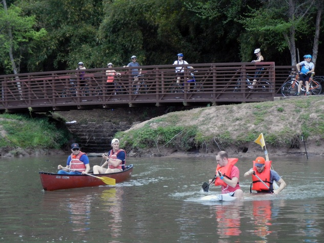9 Alan Bunker, from left and Chris Hill in a canoe and Jason Slater and Trevor Best at Anything That Floats 2014