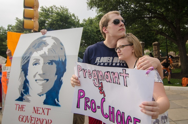 Pregnant and pro choice sign