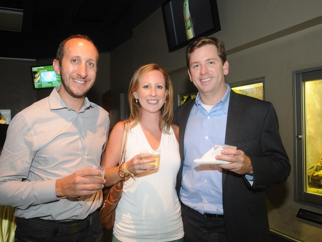 9670 Sam Cole, from left, Kristin Barber and Jared Cox at the Scales and Cocktails Houston Zoo Flock event