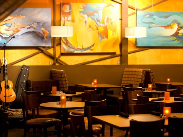 Solea Cafe Houston interior with candles and artwork