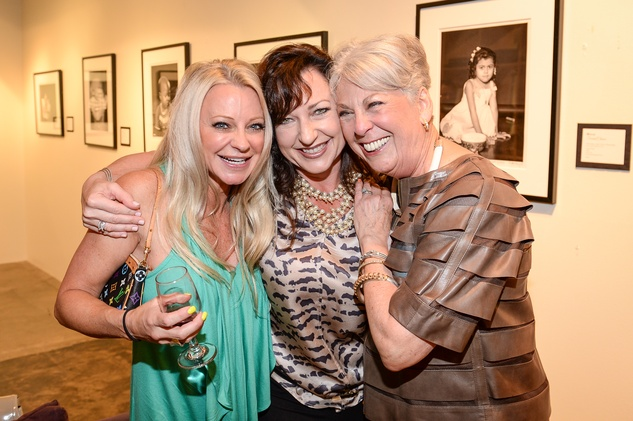 124 Debbie Arbury, from left, Dixie Green and Mary Davenport at the HeartGift photo exhibition May 2014
