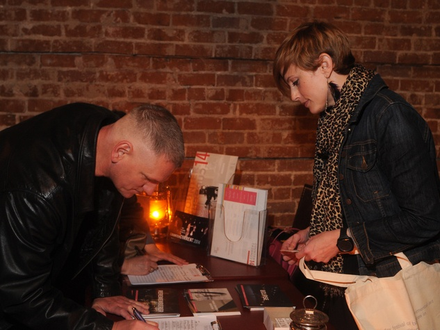 Guests signing up for CounterCurrent passes at the CounterCurrent Kick-Off March 2014 photo by George Hixson