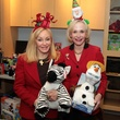 75 Judi McGee, left, and Carolyn Mann at Santa visits Texas Children's Cancer Center December 2014