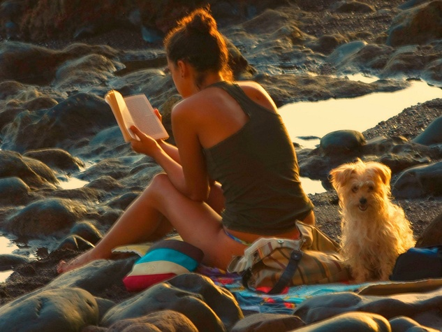 Woman reading summer beach