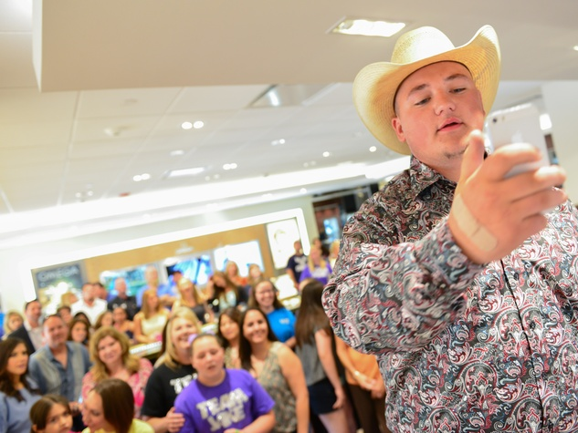 17 Jake Worthington taking a selfie with his fans at the Jake Worthington at IW Marks event June 2014