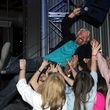 Richard Branson crowd surfs at The Rustic