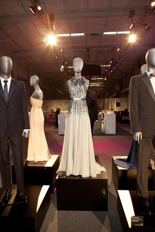 Gucci on display at the Alley Ball April 2014 silver dress designed for Mila Kunis