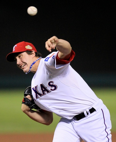 Derek Holland pitches for the Texas Rangers