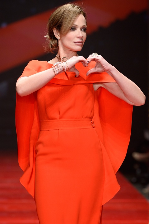 Actress Lauren Holly walks the runway at the American Heart Association's Go Red For Women Red Dress Collection 2017 presented by Macy's at Fashion Week in New York City