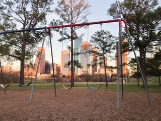 Eleanor Tinsley Park swingset downtown skyline Houston