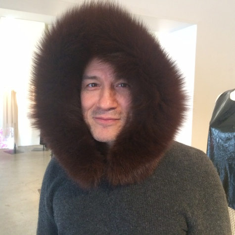 Cesar Galindo in fur hoodie at Sloan Hall