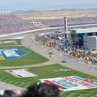 Las Vegas Motor Speedway in Nevada stadium crowd and race cars