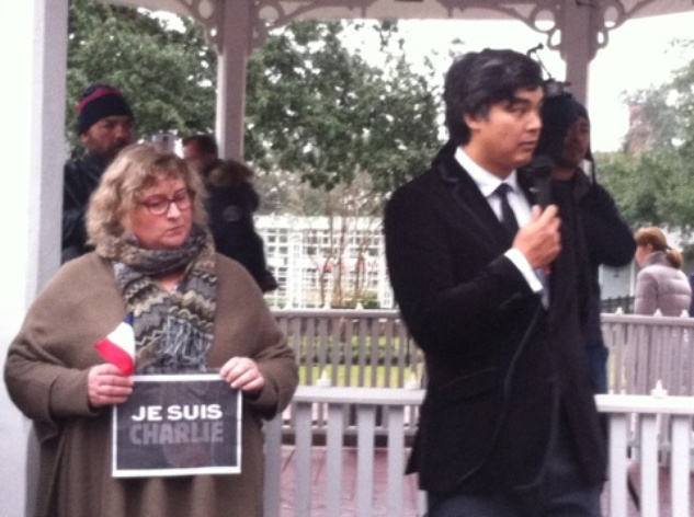 Sujiro Seam, Consul General of France, speaks to crowd at rally at Sam Houston Park