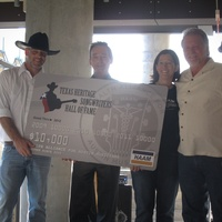 Austin Photo Set: News_Veronica_Haam_September 2011_giant check