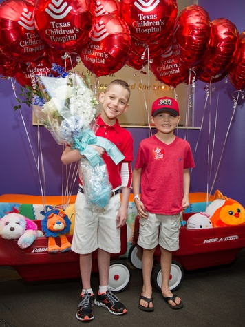 9590 Patrick DeClaire, left, and Caleb Cook at the Lester and Sue Smith Clinic dedication at Texas Children's Hospital May 2014