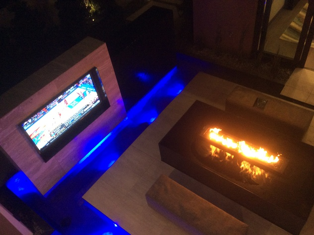 Ralph Bivins home builders convention January 2015 The New American Home show house in Las Vegas has outdoor tv and fire feature.