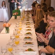 Guests at table at David Peck's first runway fashion show in new space