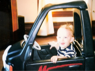 Toddler in his first car