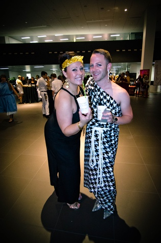 9 Event chairs Lindsey Moreno, left, and Jeremy Fain at the Bering Omega Toga Party July 2014