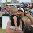 Pearland Crawfish Festival dad and son and corndog
