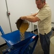 6 Yellow Rose Distilling September 2014 man pouring grains