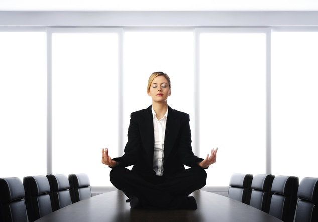 Woman in business suit meditation