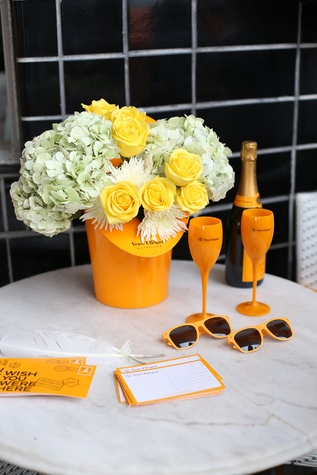 Flower arrangement with note cards and sunglasses at Veuve Clicquot at Brasserie 19