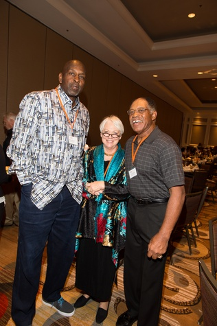77 Moses Malone, from left, Debbie Phillips and Elvin Bethea at the Dan Pastorini golf benefit October 2014