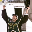 Mike Modano holding Stanley Cup