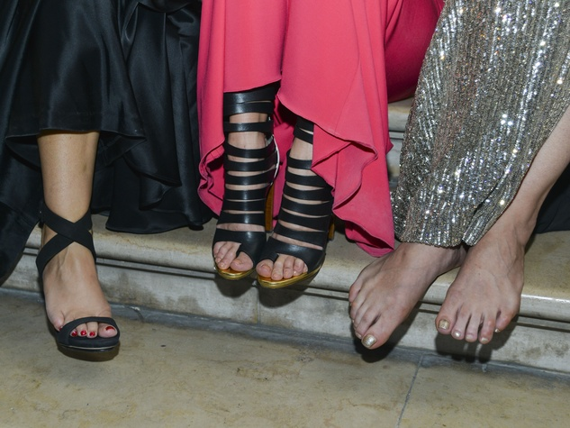Sore feet at Louvre gala on June 2013