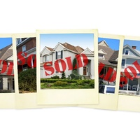 house photos with sold stamped across them
