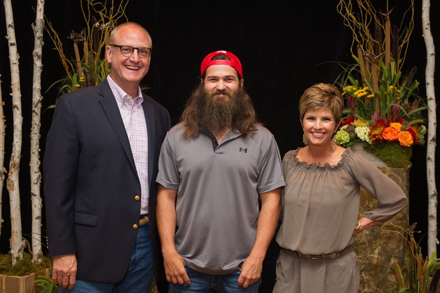 Gil Baumgarten, from left, Jep Robertson and Sue Baumgarten at the LifeHouse Houston Duck Dynasty dinner September 2014