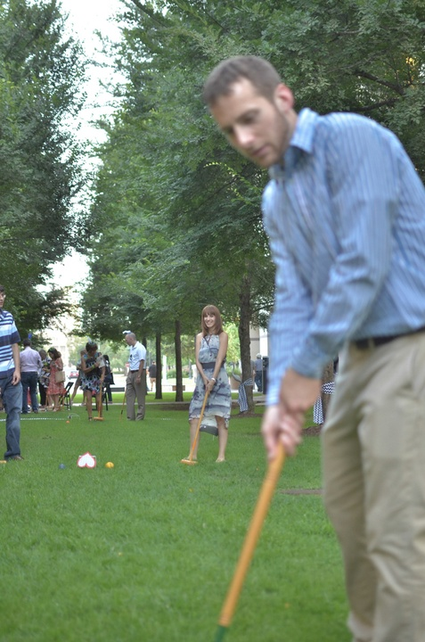 b scene Nick Schwarts and Amanda Garrett play croquet on the lawn during the party