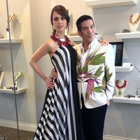 Project Runway's Daniel Esquivel with model in Austin Fashion Week dress
