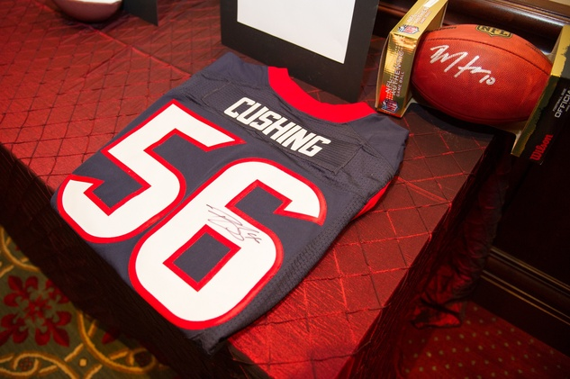 Tom Gros of NRG donated a Brian Cushing autographed Texans jersey in honor of the speaker, Jamey Rootes at the Alley Theatre Wild Things Dinner October 2014