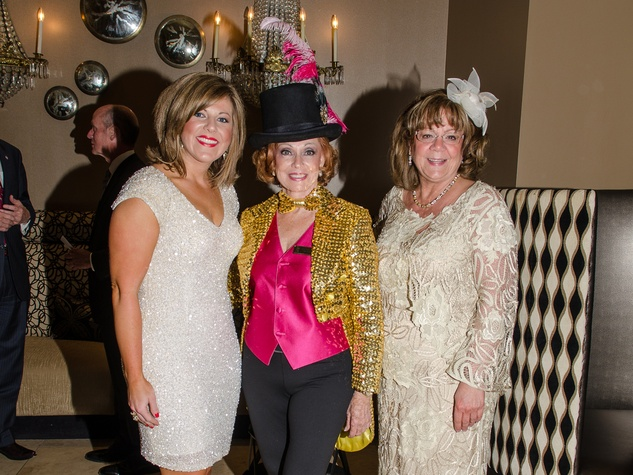 13 Kati Kasprzak, from left, Dot Cunningham and Marti Boone at the Be An Angel Gala May 2014