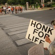 Honk for life sign at protest