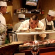 Kata Robata Sushi + Grill Chef Manabu Horiuchi cheking out live scallops before preparing